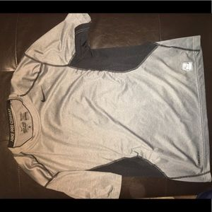 Gray Nike athletic shirt.